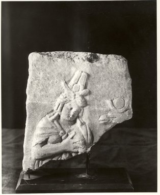 Graeco-Egyptian. Fragment with Figure, 30 B.C.E-395 C.E. Marble, 6 5/8 x 5 5/16 x 1 11/16 in. (16.9 x 13.5 x 4.3 cm). Brooklyn Museum, Gift of Evangeline Wilbour Blashfield, Theodora Wilbour, and Victor Wilbour honoring the wishes of their mother, Charlotte Beebe Wilbour, as a memorial to their father, Charles Edwin Wilbour, 16.87. Creative Commons-BY