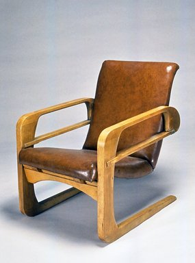 """Kem Weber (American, born Germany, 1889-1963). Armchair (""""Airline Chair""""), 1934-1935. Wood, Naugahyde, leather, metal, 34 1/4 x 25 x 34 1/2 in. (87 x 63.5 x 87.6 cm). Brooklyn Museum, Modernism Benefit Fund, 1991.104. Creative Commons-BY"""