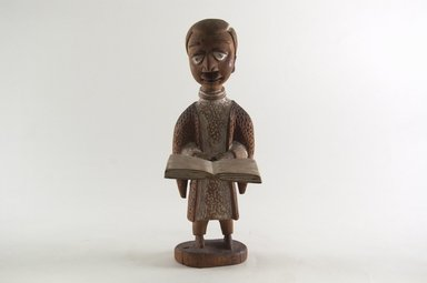 Thomas Ona Odulate (Yoruba, Nigerian, born late 19th century). Figure of a Clergyman, early 20th century. Wood, pigment, 9 3/16 x 3 1/4 in. (23.2 x 8.2 cm). Brooklyn Museum, Caroline H. Polhemus Fund, 1991.175.2. Creative Commons-BY