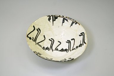 Nishapur Bowl, 9th-10th century. Buff earthenware, white engobe and brown slip, transparent glaze, 3 1/8 x 9 7/8 in. (7.9 x 25.1 cm). Brooklyn Museum, Gift of Lucile E. Selz, 1991.247.1. Creative Commons-BY
