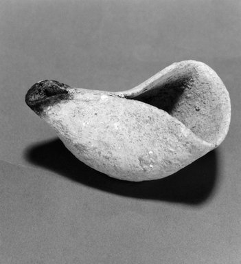 Oil Lamp. Clay, slip, 1 5/8 x 2 7/8 in. (4.2 x 7.3 cm). Brooklyn Museum, Gift of Harvey A. Herbert, 1992.46.7. Creative Commons-BY