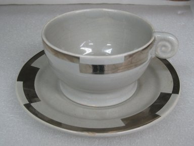 Jean Luce (French, 1895-1964). Cup and Saucer, ca. 1930. Glazed earthenware, a) cup: 2 1/4 x 4 1/4 x 3 3/4 in. (5.7 x 10.8 x 9.5 cm). Brooklyn Museum, Gift of Mark Isaacson, 1992.92.31a-b. Creative Commons-BY