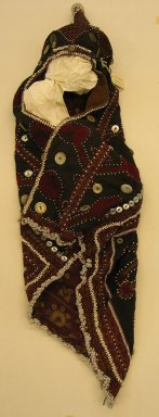 Hat, mid 20th century. Cotton cloth, buttons, coins, and beads Brooklyn Museum, Gift of Dr. and Mrs. John P. Lyden, 1994.197.7. Creative Commons-BY