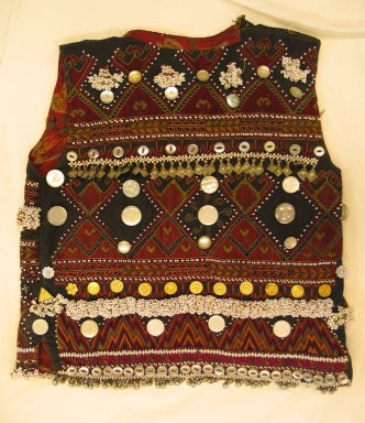 Vest, mid 20th century. Cotton cloth, buttons, metal ornaments, and beads Brooklyn Museum, Gift of Dr. and Mrs. John P. Lyden, 1994.197.9. Creative Commons-BY