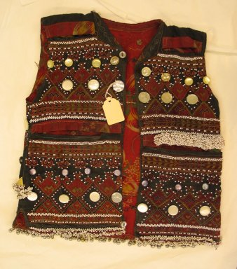 Vest, mid-20th century. Cotton cloth, buttons, metal ornaments, and beads Brooklyn Museum, Gift of Dr. and Mrs. John P. Lyden, 1994.197.9. Creative Commons-BY
