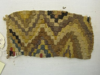 Textile Fragment, Undetermined, 1400-1532. Cotton, camelid fiber, 5 5/16 x 2 15/16in. (13.5 x 7.5cm). Brooklyn Museum, Gift of Kay Hodnett Nunez, 1995.84.16. Creative Commons-BY