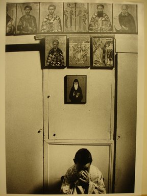 "Georgios Katsagelos. Altar Boy Praying (from ""Religious"" series), 1995. Gelatin silver photograph, Image: 15 1/4 x 10 1/4 in. (38.7 x 26.2 cm). Brooklyn Museum, Gift of the artist, 1996.193.1. © Georgios Katsagelos"