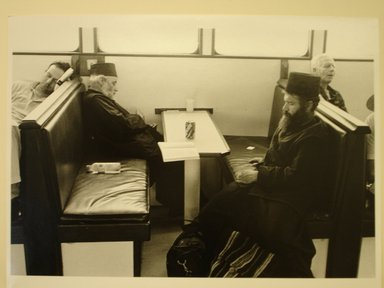 "Georgios Katsagelos. Two Priests Asleep on a Ferrryboat (from ""Religious"" series), 1995. Gelatin silver photograph, Image: 10 1/2 x 15 1/4 in. (26.8 x 38.7 cm). Brooklyn Museum, Gift of the artist, 1996.193.3. © Georgios Katsagelos"