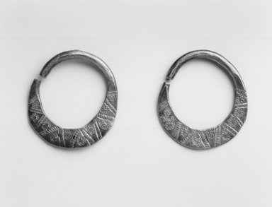 Swahili. Pair of Earrings, mid-20th century. Silver?, 1 1/4 x 1 3/8 in. (3.2 x 3.5 cm). Brooklyn Museum, Gift of Donna Klumpp Pido, 1996.204.11a-b. Creative Commons-BY