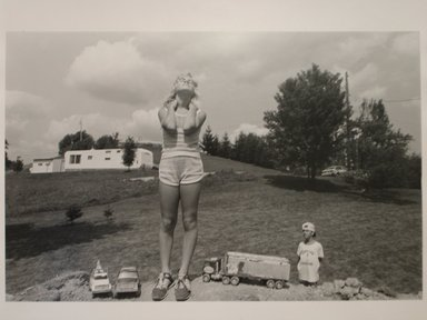 Sage Sohier (American, born 1954). T.C. Buckhannon, West Virginia (Girl with Toys with Boy Admirer), 1982. Gelatin silver photograph, image: 12 1/4 x 15 3/4 in. (31.2 x 40.1 cm). Brooklyn Museum, Gift of the artist, 1997.55.1. © Sage Sohier