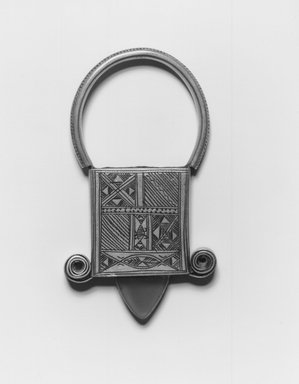Tuareg. Pendant Cross of In Gall, early 20th century. Silver, plastic, wax, 3 1/8 x 3/4 x 1 3/4 in.  (7.9 x 1.9 x 4.5 cm). Brooklyn Museum, Gift of Mark S. Rapoport, M.D. and Jane C. Hughes, 1998.12.5. Creative Commons-BY