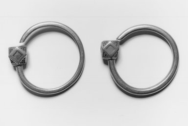 Tuareg. Pair of Earrings (Tsabit), early 20th century. Silver, 3/4 x 2 1/2 x 2 1/2 in. (1.9 x 6.4 x 6.4 cm). Brooklyn Museum, Gift of Mark S. Rapoport, M.D. and Jane C. Hughes, 1998.12.9a-b. Creative Commons-BY