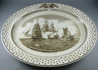 Josiah Wedgwood & Sons Ltd. (founded 1759). Platter, Old Ironsides, 20th century, c1938. Glazed earthenware, 2 x 19 x 15 5/8 in.  (5.1 x 48.3 x 39.7 cm). Brooklyn Museum, Gift of Jason and Susanna Berger, 1999.103.31. Creative Commons-BY