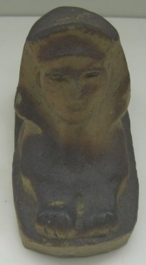Unknown. Sphinx-Shaped Doorstop, 20th century. Glazed earthenware, 5 x 3 3/4 x 8 3/4 in. (12.7 x 9.5 x 22.2 cm). Brooklyn Museum, Gift of Paul F. Walter, 1999.108.11. Creative Commons-BY