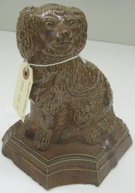 Dog-Shaped Doorstop, 19th or 20th century. Glazed earthenware, 9 1/2 x 8 x 6 1/2 in. (24.1 x 20.3 x 16.5 cm). Brooklyn Museum, Gift of Paul F. Walter, 1999.108.13. Creative Commons-BY