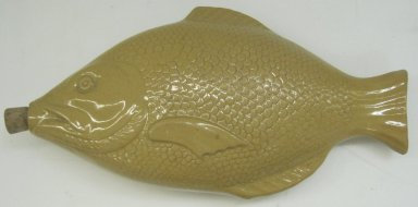Fish-Shaped Flask, 19th or 20th century. Glazed earthenware and cork, 2 x 12 x 6 in. (5.1 x 30.5 x 15.2 cm). Brooklyn Museum, Gift of Paul F. Walter, 1999.108.8. Creative Commons-BY