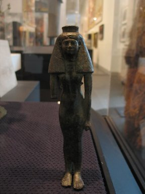 Figure of a Princess or Divine Consort of Amun, ca. 760-656 B.C.E. Bronze, 7 5/8 x 2 1/8 x 1 3/8 in. (19.4 x 5.4 x 3.5 cm). Brooklyn Museum, Gifts in memory of Christos G. Bastis and Charles Edwin Wilbour Fund, 1999.110. Creative Commons-BY