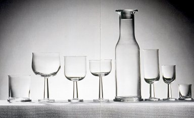 Ettore Sottsass Jr. (Italian, born Austria, 1917-2007). Glass for Water, Red and White Wine, 'Ginevra' Pattern, Model TCES 1/1, Designed 1996. Colorless glass, 5 7/8 x 3 1/8 in.  (15.0 x 8.0 cm). Brooklyn Museum, Gift of Alessi S.p.A., 1999.40.63. Creative Commons-BY