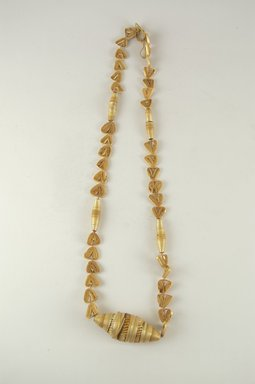 Tuareg. Necklace, 1981. Wax, straw, Length: 26 1/2 in. (67.3 cm). Brooklyn Museum, Gift of William C. Siegmann, 2000.39.1. Creative Commons-BY