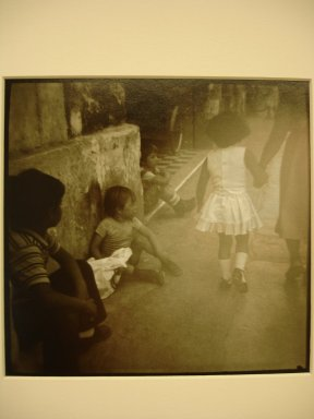 Jonathan Bailey (American, born 1954). Merida, Yucatan (Boys Watching Girl), 1983. Gold toned gelatin silver photograph, image: 5 1/2 x 5 1/2 in. (14 x 14 cm). Brooklyn Museum, Gift of the artist, 2000.65.2. © Jonathan Bailey