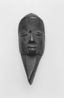 Mano. Miniature Mask, late 19th-early 20th century. Wood, aluminum, 6 x 2 3/8 x 1 7/8 in.  (15.2 x 6.0 x 4.8 cm). Brooklyn Museum, Gift of Blake Robinson, 2000.70.4. Creative Commons-BY