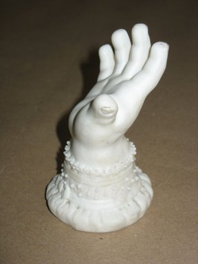 Hand, ca. 1850. Unglazed porcelain, 4 1/8 x 2 15/16 x 2 7/8 in.  (10.5 x 7.5 x 7.3 cm). Brooklyn Museum, Gift of C. Deirdre Phelps in memory of Southwick Phelps, 2001.13.3. Creative Commons-BY