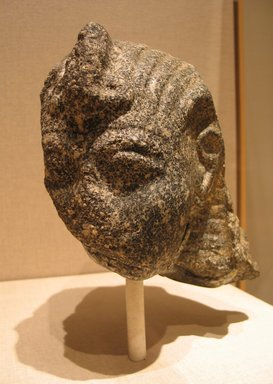 Fragmentary Head of A King, probably Ramesses II, ca. 1279-1213 B.C.E. Gray granite, 7 11/16 x 6 7/8 x 9 1/16 in.  (19.5 x 17.5 x 23.0 cm). Brooklyn Museum, Partial gift of James Lamb in honor of Paul O'Rourke and Charles Edwin Wilbour Fund, 2001.56. Creative Commons-BY
