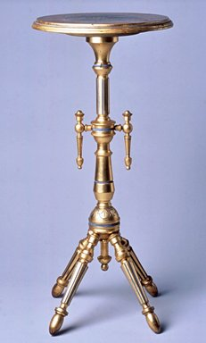 Attributed to George Jacob Hunzinger (American, born Germany, 1835-1898). Stand, ca. 1875. Various woods, gilt, pigment, height: 33 1/8 in. (84.1 cm); diameter: 15 1/8 in. (38.4 cm). Brooklyn Museum, Gift of Robert Tuggle, 2002.17.3. Creative Commons-BY