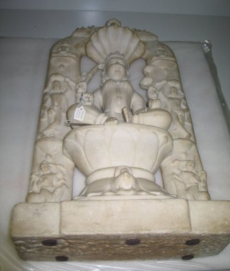 Seated Divinity Surrounded by Tirthankaras, 15th century. White marble, 29 1/8 x 13 9/16 x 5 5/16 in. (74 x 34.5 x 13.5 cm). Brooklyn Museum, Gift of Dr. Alvin E. Friedman-Kien, 2004.112.21. Creative Commons-BY