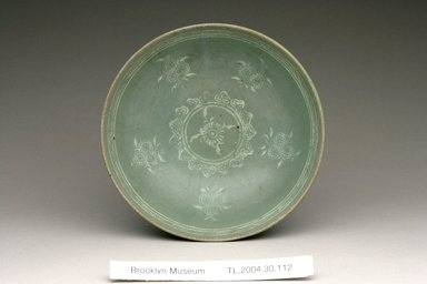Bowl, 13th century. Stoneware with celadon glaze and inlaid black and white slip, Height: 1 3/4 in. (4.4 cm). Brooklyn Museum, The Peggy N. and Roger G. Gerry Collection, 2004.28.130. Creative Commons-BY