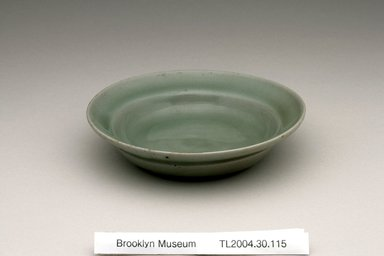 Dish, 12th century. Stoneware with celadon glaze, Height: 1 1/4 in. (3.2 cm). Brooklyn Museum, The Peggy N. and Roger G. Gerry Collection, 2004.28.133. Creative Commons-BY
