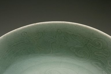 Bowl, last half of the 12th century. Stoneware with celadon glaze , Height: 1 5/16 in. (3.3 cm). Brooklyn Museum, The Peggy N. and Roger G. Gerry Collection, 2004.28.243. Creative Commons-BY