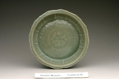 Dish, 12th century. Stoneware with celadon glaze, Height: 1 1/16 in. (2.7 cm). Brooklyn Museum, The Peggy N. and Roger G. Gerry Collection, 2004.28.42. Creative Commons-BY