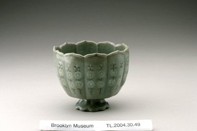 Cup, first half of the 13th century. Stoneware inlaid with black and white slip and celadon glaze, Height: 2 13/16 in. (7.2 cm). Brooklyn Museum, The Peggy N. and Roger G. Gerry Collection, 2004.28.45. Creative Commons-BY