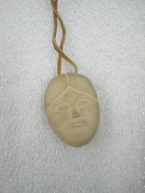 Therese Ukaleannuk. Janus-faced Amulet Head, March 1974, 1950-1980. Tan stone, 2 x 1/2 x 3/4 in. (5.1 x 1.3 x 1.9 cm). Brooklyn Museum, Hilda and Al Schein Collection, 2004.79.28. Creative Commons-BY