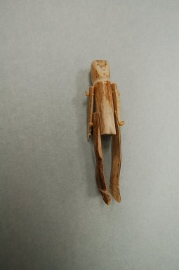 Inuit. Figure with Movable Arms and Legs, 1950-1980. Bone, cord, 5 7/8 x 1 1/4 x 1 in. (14.9 x 3.2 x 2.5 cm). Brooklyn Museum, Hilda and Al Schein Collection, 2004.79.50. Creative Commons-BY