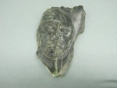 Inuit. Carved Face in Relief, 1950-1980. Green stone, 3 1/2 x 2 1/4 x 1 in. (8.9 x 5.7 x 2.5 cm). Brooklyn Museum, Hilda and Al Schein Collection, 2004.79.65. Creative Commons-BY