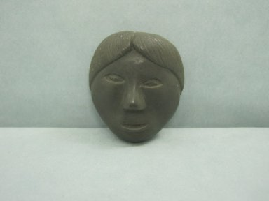 Inuit. Amulet in the Form of a Head, 1950-1980. Soapstone, 1 5/8 x 1 3/8 x 5/8 in. (4.1 x 3.5 x 1.6 cm). Brooklyn Museum, Hilda and Al Schein Collection, 2004.79.71. Creative Commons-BY