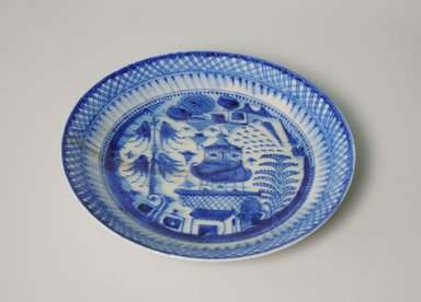 Plate, late 19th-early 20th century. Ceramic with blue and white decoration