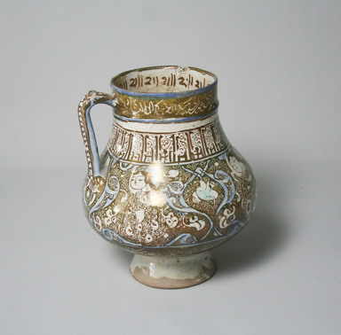 Beaker, 13th century. Ceramic; fritware, painted in luster and blue over an opaque white glaze, 6 3/4 x 6 in. (17.1 x 15.2 cm). Brooklyn Museum, Museum Expedition 1913-1914, Museum Collection Fund, by exchange, 2009.41. Creative Commons-BY