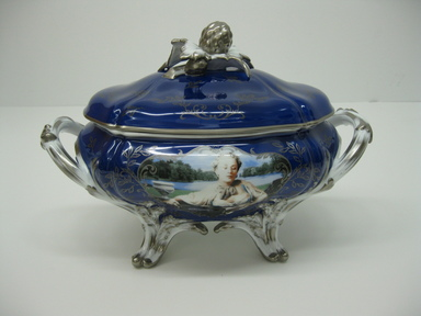 """Cindy Sherman (American, born 1954). Tureen with Cover and Under Plate, """"Madame de Pompadour (nee Poisson) Pattern,"""" 1990. Porcelain with painted and silk-screened decoration, Tureen with Cover: 10 1/4 x 14 5/8 x 9 1/4 in. (26 x 37.1 x 23.5 cm). Brooklyn Museum, Gift of the Estate of Mary Hayward Weir, by exchange, 2009.47a-c. Creative Commons-BY"""