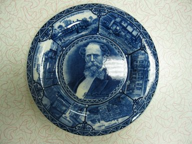 The Rowland & Marsellus Company (1893-1938). Charles Dickens Plate, Registered 1904, Made: early 20th century. Glazed earthenware, 1 1/8 x 11 in. (2.9 x 27.9 cm). Brooklyn Museum, Gift of Pat Nichols in honor of Joanne Leshen, 2009.77.1. Creative Commons-BY