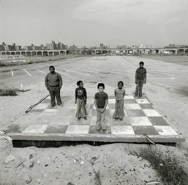 Arthur Tress (American, born 1940). Boys on Checker Floor, Far Rockaway, NY, 1980. Gelatin silver photograph, 11 x 14 in. (27.9 x 35.6 cm). Brooklyn Museum, Gift of William and Marilyn Braunstein, 2009.86.8. © artist or artist's estate