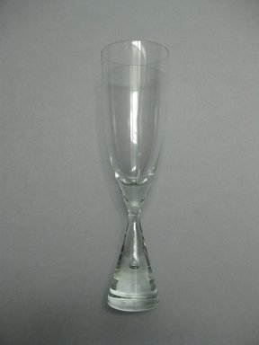 Bent Severin (Danish, born 1925). Champagne Flute, Princess Pattern, designed 1957, manufactured 1958-1984. Glass, height: 8 1/2 in. (21.6 cm); diameter: 2 5/16 in. (5.9 cm). Brooklyn Museum, Gift of The American College in memory of Charles J. Zimmerman, CLU®, 2010.14.3. Creative Commons-BY