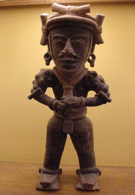 Veracruz. Standing Warrior Figure, ca. 200-500 AD. Ceramic, pigment from plant saps, resins, crushed plants, asphalt, and black soot, 21 1/2 x 9 1/2 x 5 3/4 in. (54.6 x 24.1 x 14.6 cm). Brooklyn Museum, Gift of the Coltrera Collection, 2010.23.3. Creative Commons-BY