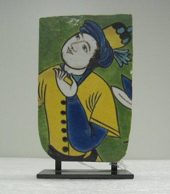 Fragmentary Tile with Figural Decoration, 17th century. Ceramic; fritware, painted in yellow, turquoise, cobalt blue, green, black, opaque white, and ochre brown glazes with manganese purple in the cuerda seca (dry-cord) technique., 6 1/2 x 4 x 2 in. (16.5 x 10.2 x 5.1 cm). Brooklyn Museum, Gift of Mr. and Mrs. Robert L. Poster in memory of Dr. Bertram H. Schaffner, 2010.45.1. Creative Commons-BY