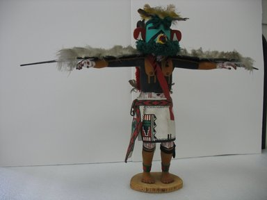 probably Henry Shelton (born 1929). Kachina Doll, 1960-1970. Cottonwood root, acrylic pigment, feathers, yarn, leather, 19 1/2 x 27 x 5 in. (49.5 x 68.6 x 12.7 cm). Brooklyn Museum, Gift of Edith and Hershel Samuels, 2010.6.13. Creative Commons-BY