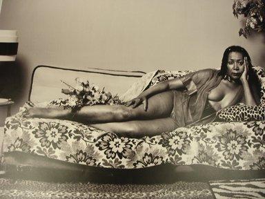 Mickalene Thomas (American, born 1971). Madame Mama Bush in Black and White, 2007; printed 2011. Chromogenic photograph, Sheet: 18 3/4 x 23 1/2 in. (47.6 x 59.7 cm). Brooklyn Museum, Gift of Mickalene Thomas, 2011.26. ©Mickalene Thomas