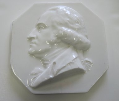 Karl L. H. Mueller (American, born Germany, 1820-1887). Plaque, Portrait of George Washington, ca. 1876. Porcelain, 5/8 x 5 7/8 x 5 7/8 in. (1.6 x 14.9 x 14.9 cm). Brooklyn Museum, Harold S. Keller Fund, 2011.40.2. Creative Commons-BY