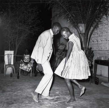 Malick Sidibé. Nuit de Noël (Happy Club), 1972/2011. Gelatin silver photograph, Image: 24 x 24 in. (61 x 61 cm). Brooklyn Museum, Frederick Loeser Fund and Alfred T. White, 2011.67.1. ©Malick Sidibé